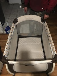 Baby's gray and white travel cot 46 km