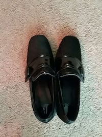 pair of black patent leather slip on shoes