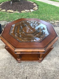 brown wooden framed glass top coffee table Pearland, 77584