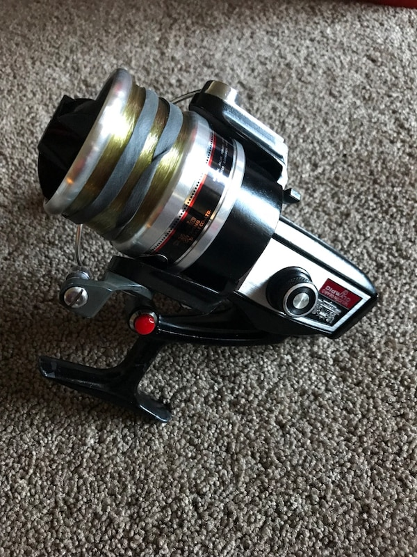 Dx olympic reel model number is lg dx #4. this reel is new , has never touched water . is made for salt water and crabbing is very big. Comes with 20 pound mono