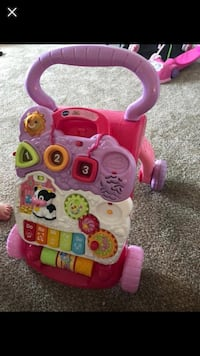 toddler's pink and purple learning walker