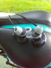 black and white in-ear earphones