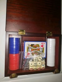 Brand new poker set with cards and dice in a beautiful wooden box