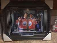 two ice hockey player poster and black frame
