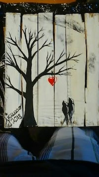 two black bird and leafless tree painted board
