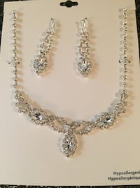 silver-colored necklace and earrings 776 km