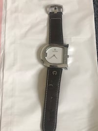 round silver analog watch with black leather strap Los Angeles, 90024