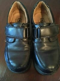 pair of black velcro strap leather dress shoes