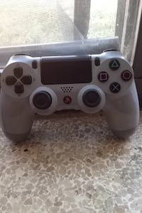 gray and black Sony PS4 controller
