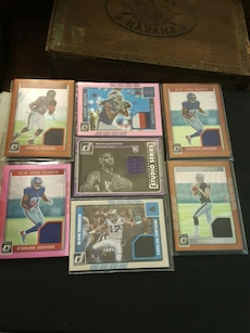 assorted football trading cards