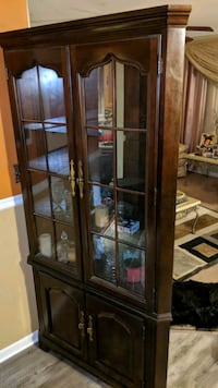 brown wooden framed glass display cabinet Baltimore, 21207