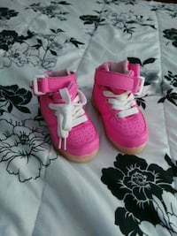 pair of pink light up high top sneakers