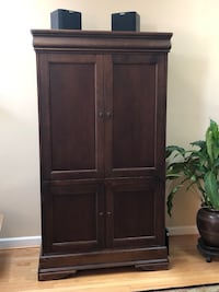 Solid wood entertainment Armoire by Hooker