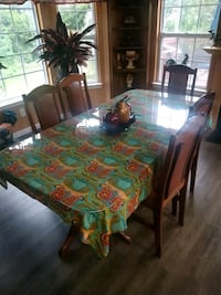 Wood dining table with protective custom glass Ashburn