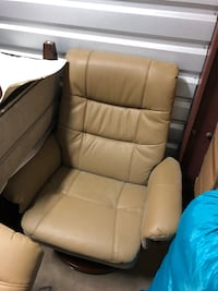 brown leather padded sofa chair