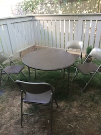 round black metal patio table with four chairs Louisville, 40242