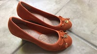 pair of brown leather flats Novena