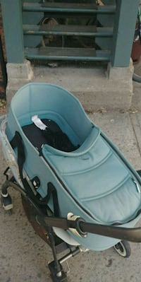baby's blue and black car seat carrier