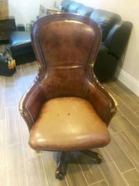 brown wooden frame brown leather padded armchair Vaughan, L0J 1C0