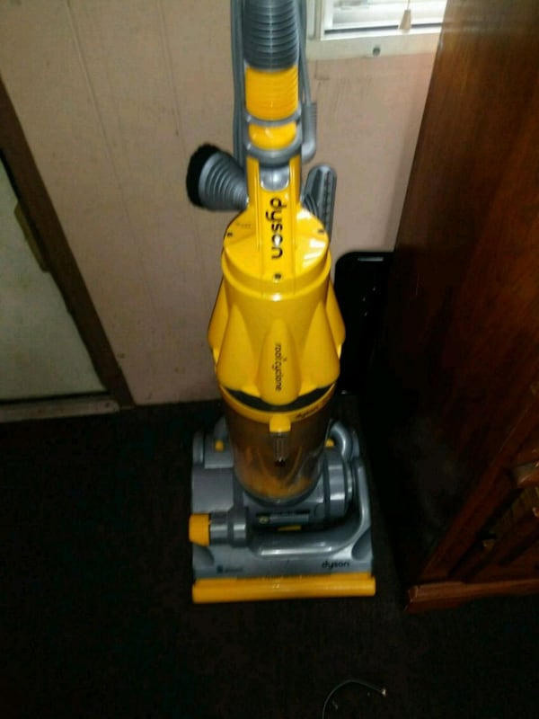 yellow and gray Dyson upright vacuum cleaner 061bfeaf-5e2c-43a7-816d-6182ebab302b