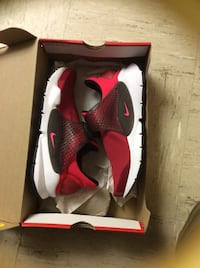 pair of red-and-white Nike basketball shoes