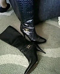 pair of black leather heeled boots Albuquerque, 87121