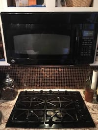 Black LG microwave oven $50, gas cooktop $300 131 mi