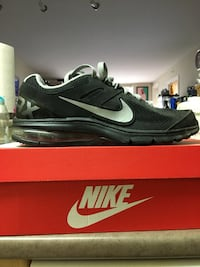 Unpaired black and gray nike air max shoe with box