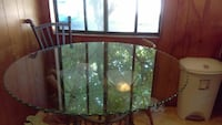 round glass top black steel frame dining table