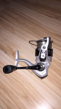 Pflueger black and gray fishing real. 10/10 condition with 12 pound monofilament line Richmond, V7E