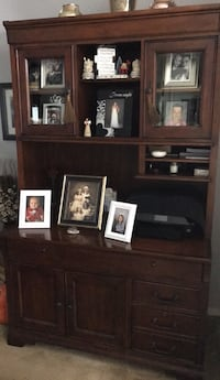 brown wooden TV hutch with flat screen television Mableton, 30126