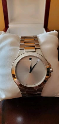 Movado Watch silver, white Pearl backing, mint condition.