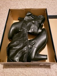 women's pair of black leather boots in box