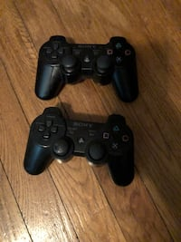 two black Sony PS3 controllers Jacksonville, 32216