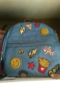 Blue backpack with sewed-on patches San Bernardino, 92404