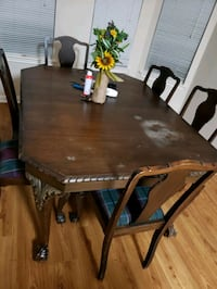 rectangular brown wooden table with four chairs dining set Austin