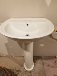 White pedestal sink with brush nickel faucet. In great shape
