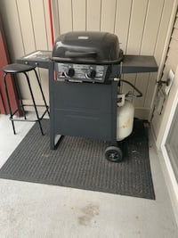Barbecue grill with full propane gas tank and with the black rug Surrey, V3S 4P2