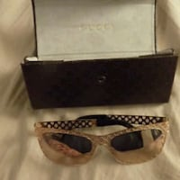 silver-colored framed sunglasses with box
