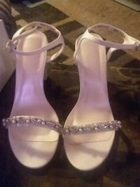 pair of white leather open-toe ankle strap heels Mishawaka, 46544