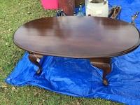 oval brown wooden coffee table 330 mi
