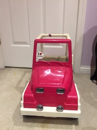 toddler's pink and white ride-on toy car