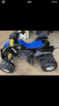 Black and blue atv ride on toy