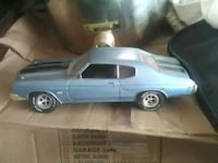blue and white die-cast car West Monroe