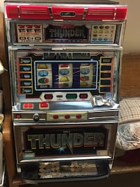 Red silver and black thunder game machine