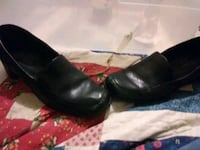 pair of black leather slip-on shoes Clarksville, 37043
