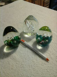 three round green cut glass ornaments and white-an