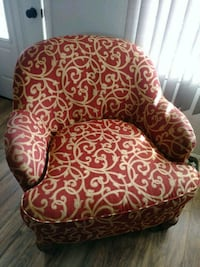 Two arm chairs with ottoman