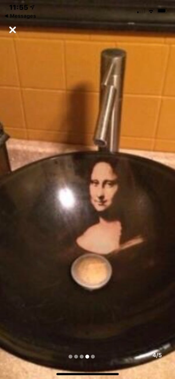 Brand new Black Glass Mona Lisa VESSEL SINK Was 459. Never installed.  52052b40-bff5-4e47-89b9-fd18956578c8