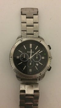 Round black fossil chronograph watch with silver link bracelet